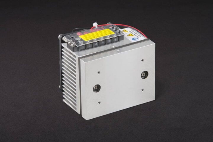 Three-quarter view of thermoelectric cold plate cooler/heater. Cooled aluminum plate on the front, waste heat exhausted to fins on back. Fins are fan cooled. The fan air enters on the middle back and exhausts on sides. Operates on 12 volts DC and removes 30 watts of heat at a 0°C temperature difference relative to ambient. Can heat to 100°C without damaging the cooler.